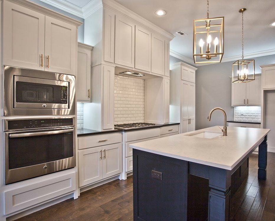 black kitchen island with white kitchen cabinets beveled white rh pinterest com
