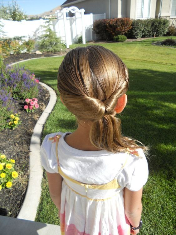 Twistback Flip Under Take A Regular Ponytail To The Next Level With Just A Little Flip Of The Wrist Hair Styles Little Girl Hairstyles Toddler Hairstyles Girl