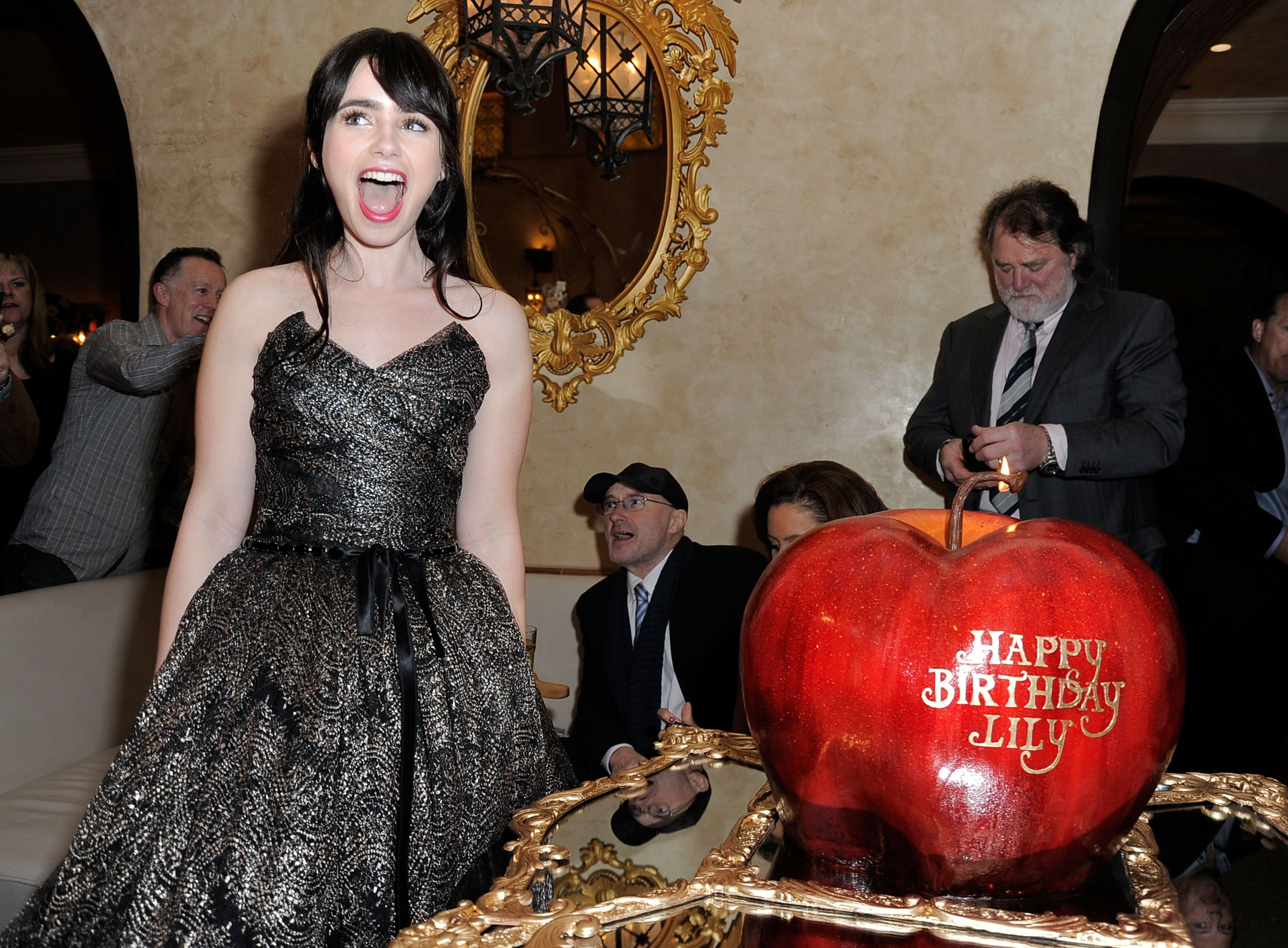 Lily Collins got a surprise 23rd Birthday cake at the LA premiere of