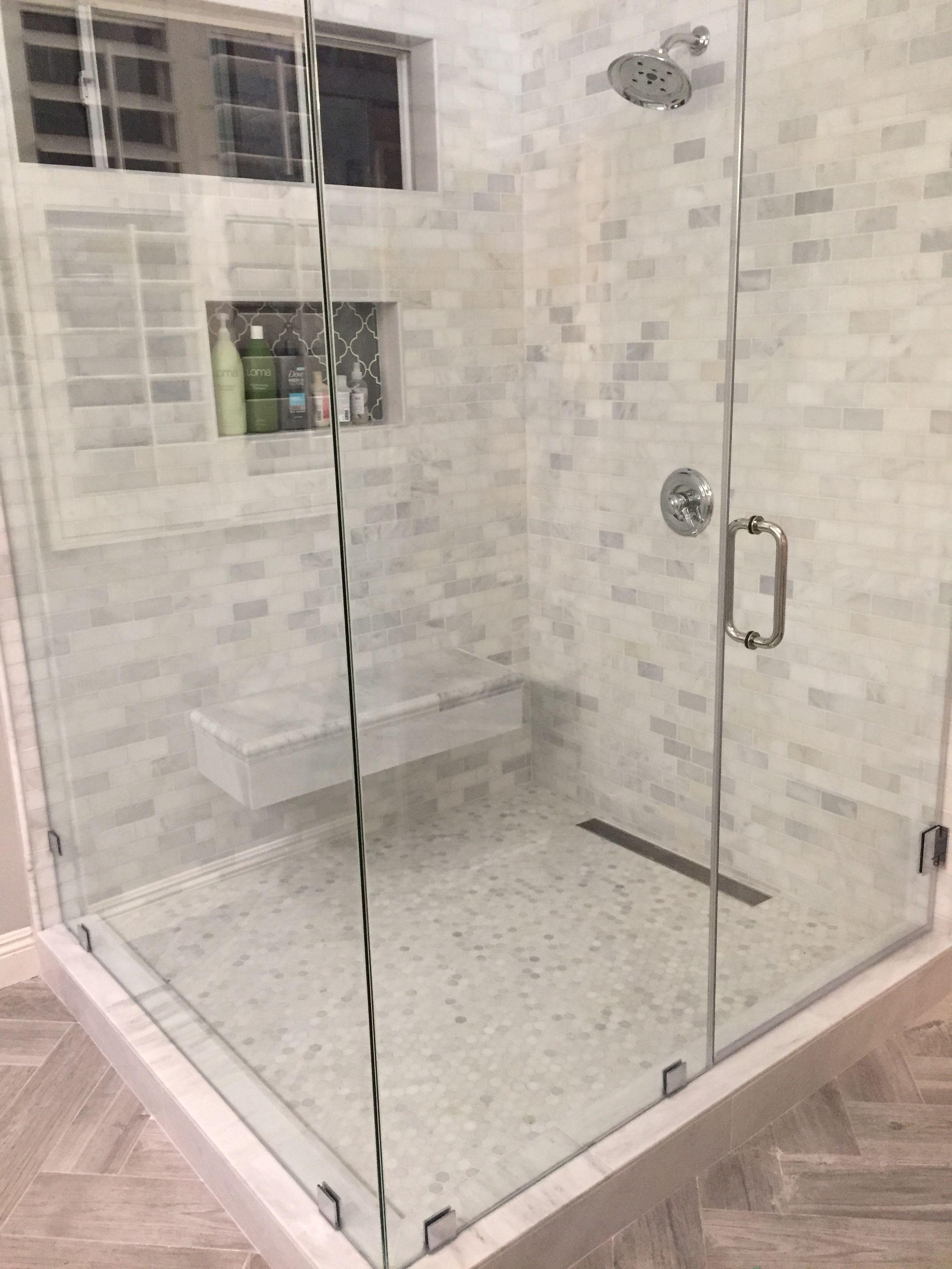 Asia Carrera Marble new carrera marble shower, herringbone wood tile floor