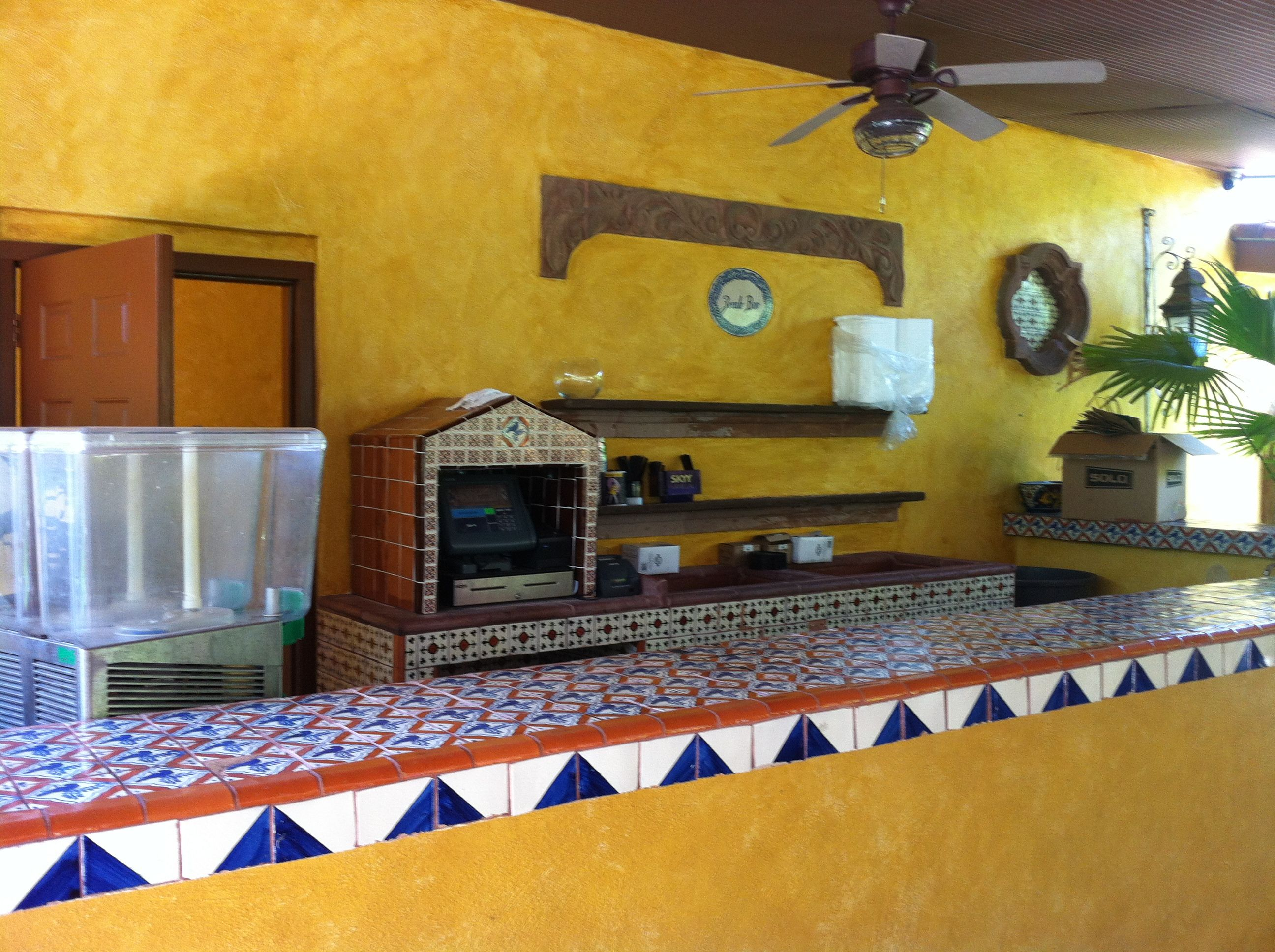 Outdoor bar at Joe T Garcia\'s: Cement block covered in stucco and ...