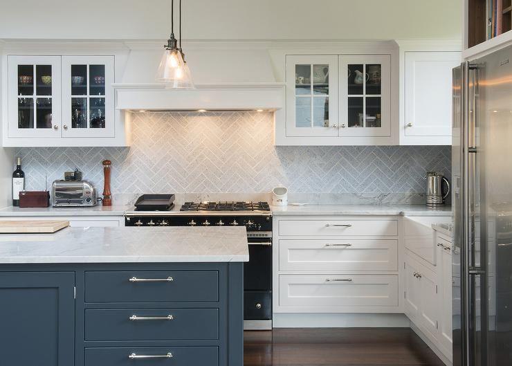 Beautiful kitchen features mini glass cone pendants illuminating a