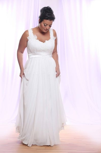You can request this plus size bridal gown to have a long train ...