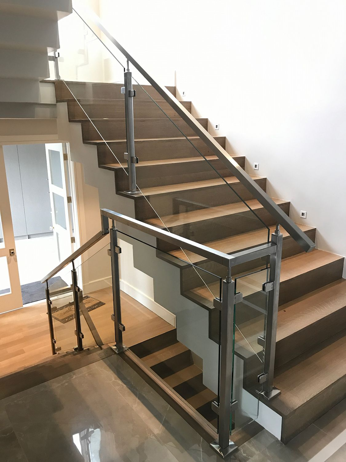 Indital Stainless Steel Square Newel Post With Glass Clamps   Stainless Steel Staircase Railing With Glass   Infill   Custom Glass   Indoor   Panel   Modern