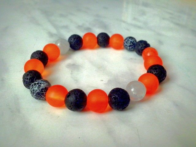 Volcano bracelet. Real black lava beads, icy agate (black with white cracks), white opaque cracked beads and matte neon orange beads looking like raw liquid lava or magma. Inspiration for tropical fire souls ;)
