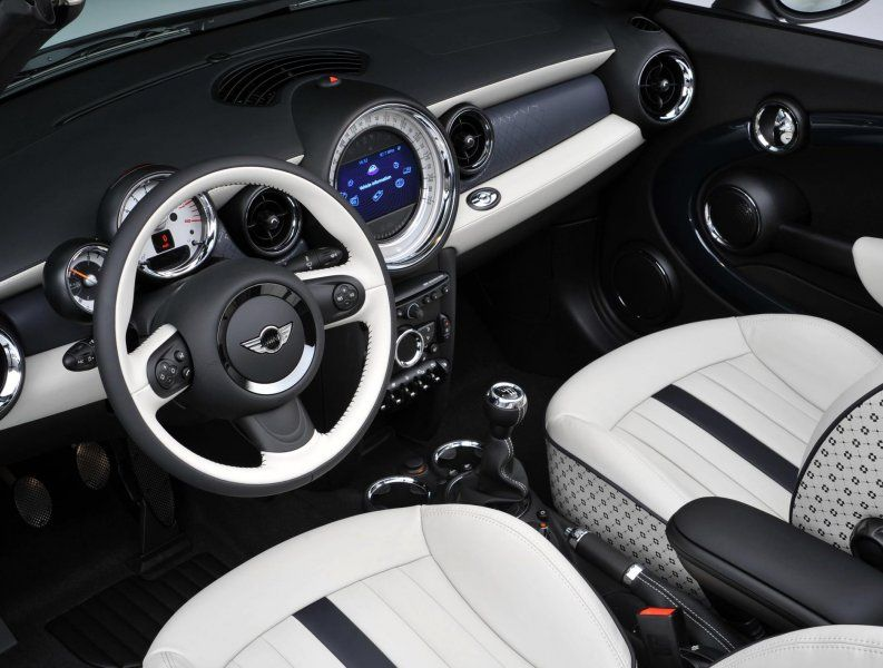 the interior of the 2 millionth mini a white silver metallic mini cabrio with denim blue top