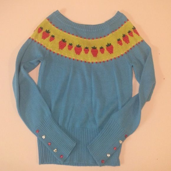 Sweet Strawberry Sweater Super cute little sweater with fun strawberries and cute little buttons. slightly cinched at bottom hem to give the sweater some shape. Fits true to size. Great condition. 66% acrylic, 28% wool, 4% lambs wool, 2% other fibers. Lux Sweaters Crew & Scoop Necks