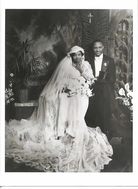 FOR BETTER OR WORSEFormal studio wedding portrait of an African ...