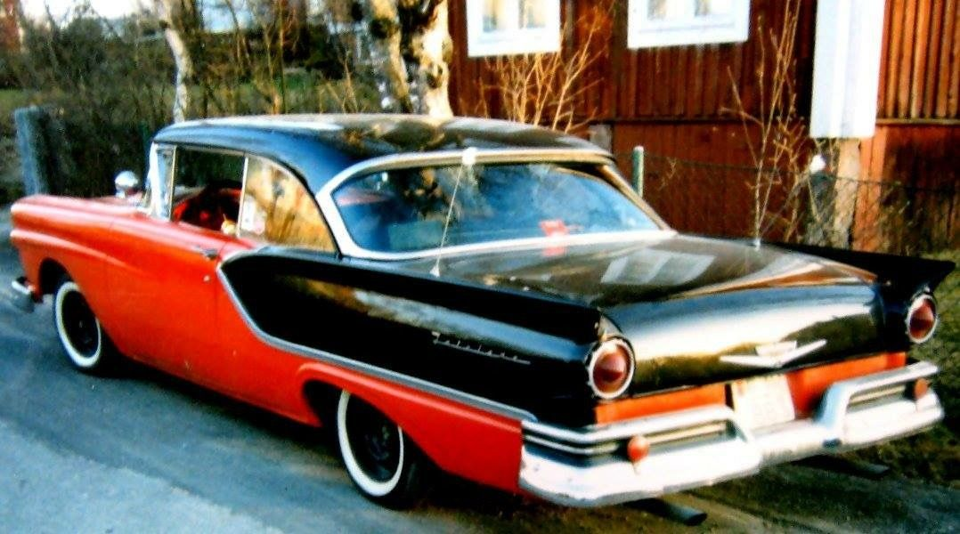 Red And Black 1957 Ford Club Victoria Does Not Appear To Be A