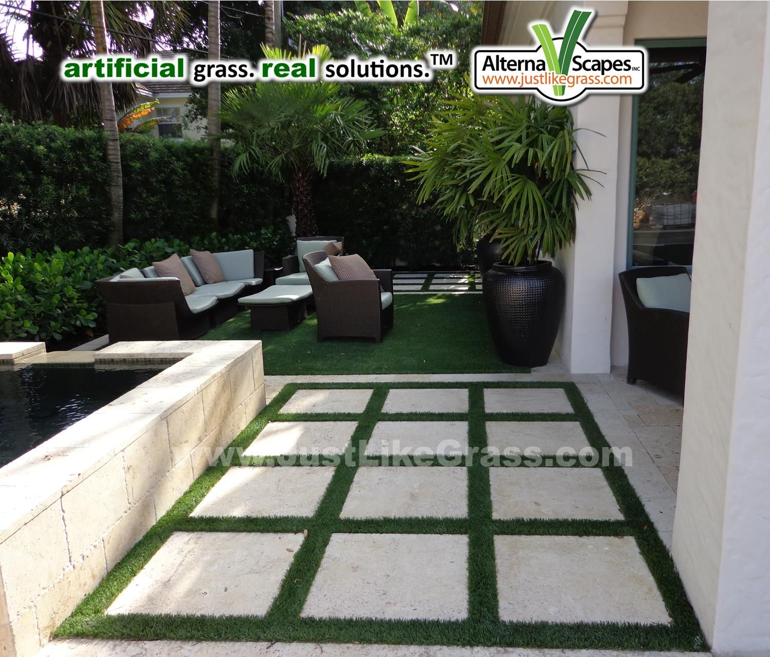 Seating area situated on artificial grass beside a water fountain