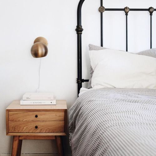 I Love The Pairing Of A Black Metal Bed With Grey Ticking Stripe And A Mid Century Modern Nightstand Remodel Bedroom Home Bedroom Bedroom Inspirations
