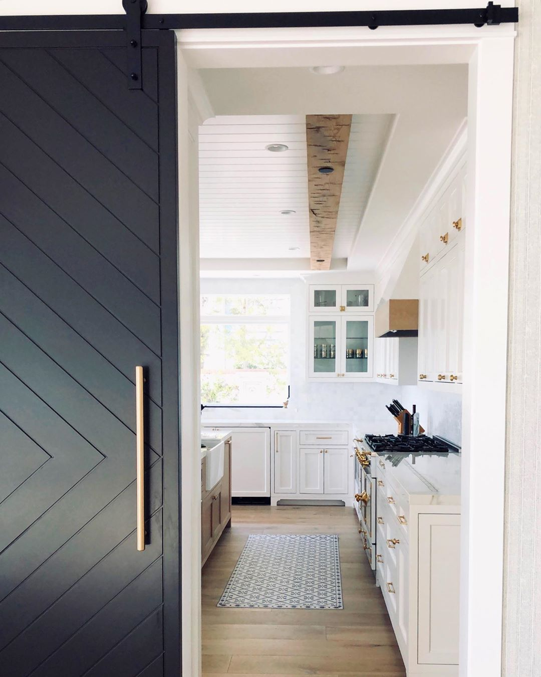 "Jill Johnson on Instagram: ""We love this barn door that separates the dining room from the kitchen in our #newportproject  #coastalchic @coastalliving #newporthome…"""