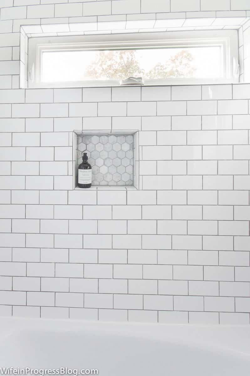 Medium Gray Grout White Subway Tile Hexagon Marble Tile In Shampoo Niche Whitetiledbathroom White Subway Tile Bathroom Tile Bathroom Subway Tiles Bathroom