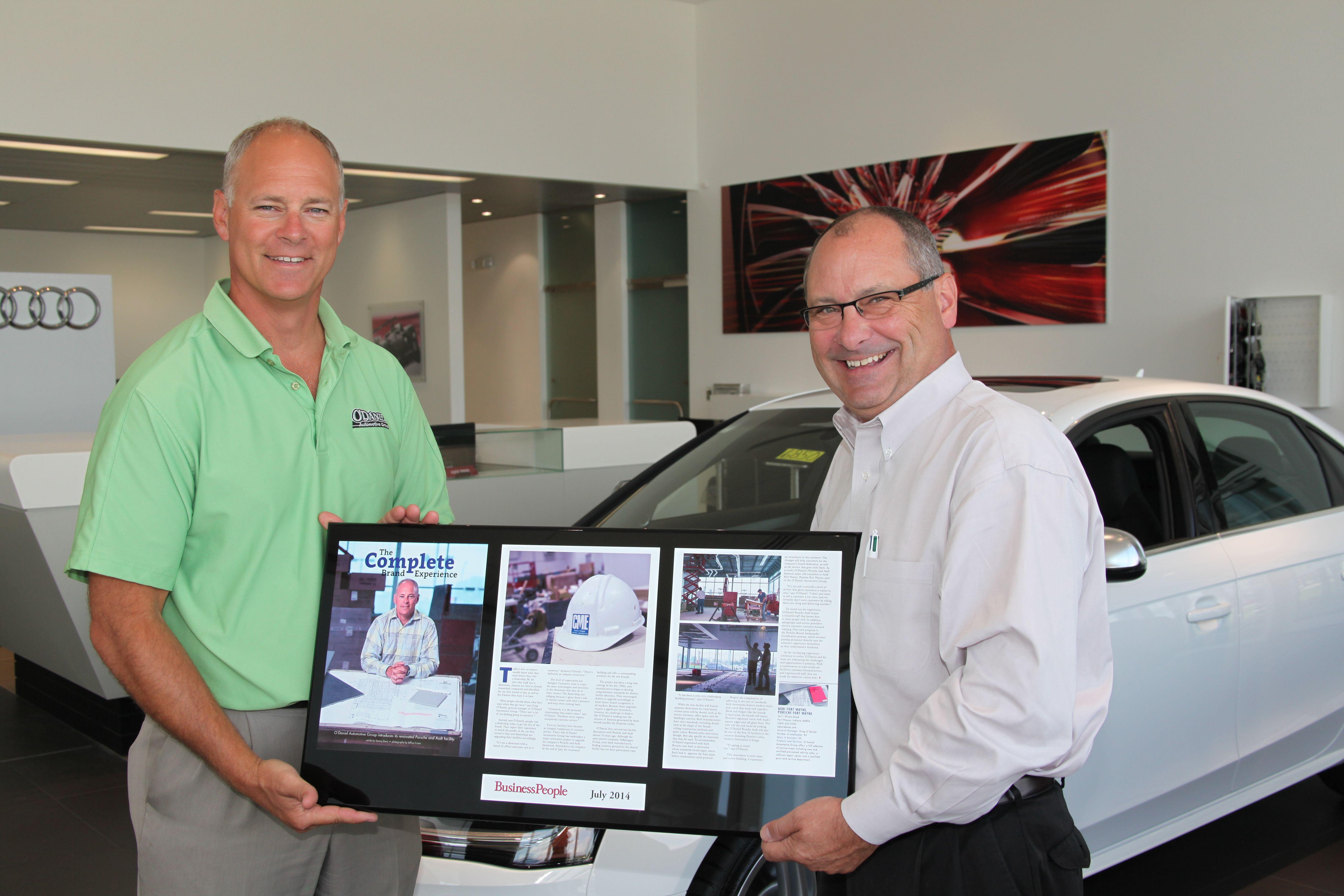 Greg O Daniel Receiving Plaque From Mark Hellinger On The Completion Of Audi Fort Wayne Porsche Dealerships Renovation And Expansion