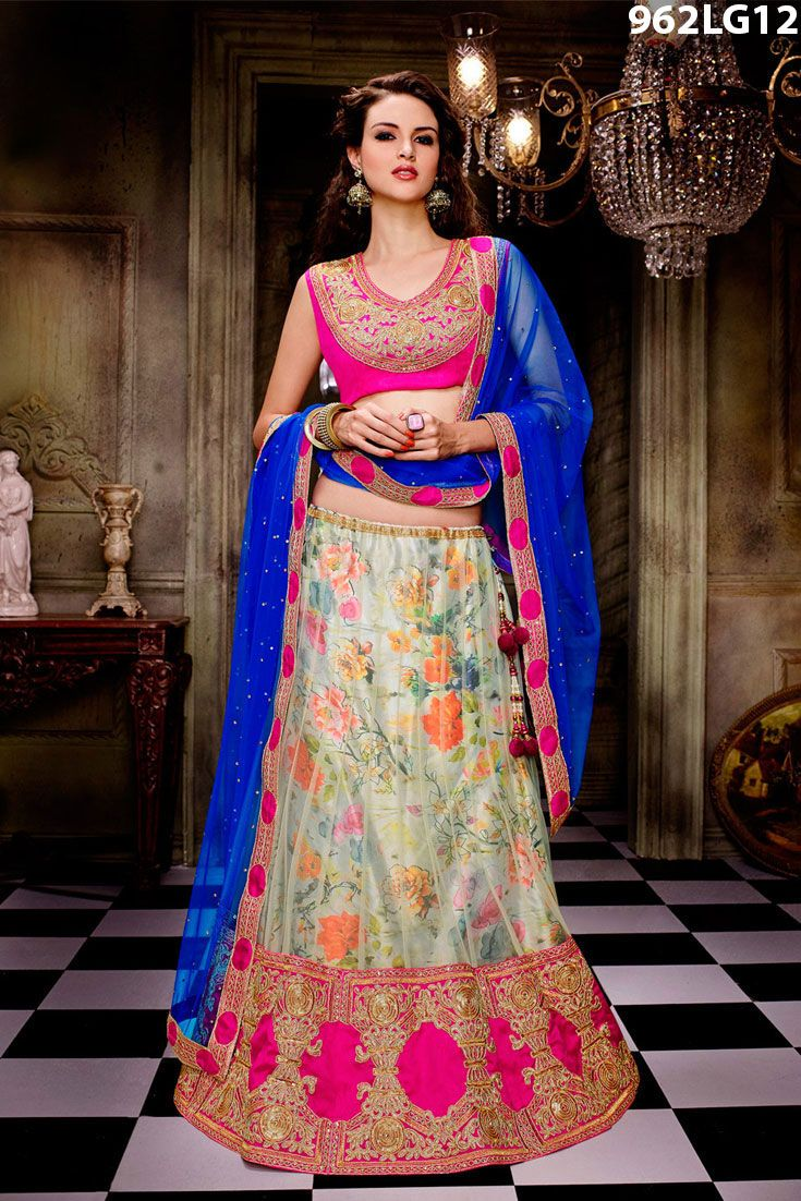 Off white net lehenga enhanced with sequins, zari, resham embroidery and patch border work. Pink art silk choli and blue net dupatta are available with this.Price US$ 107