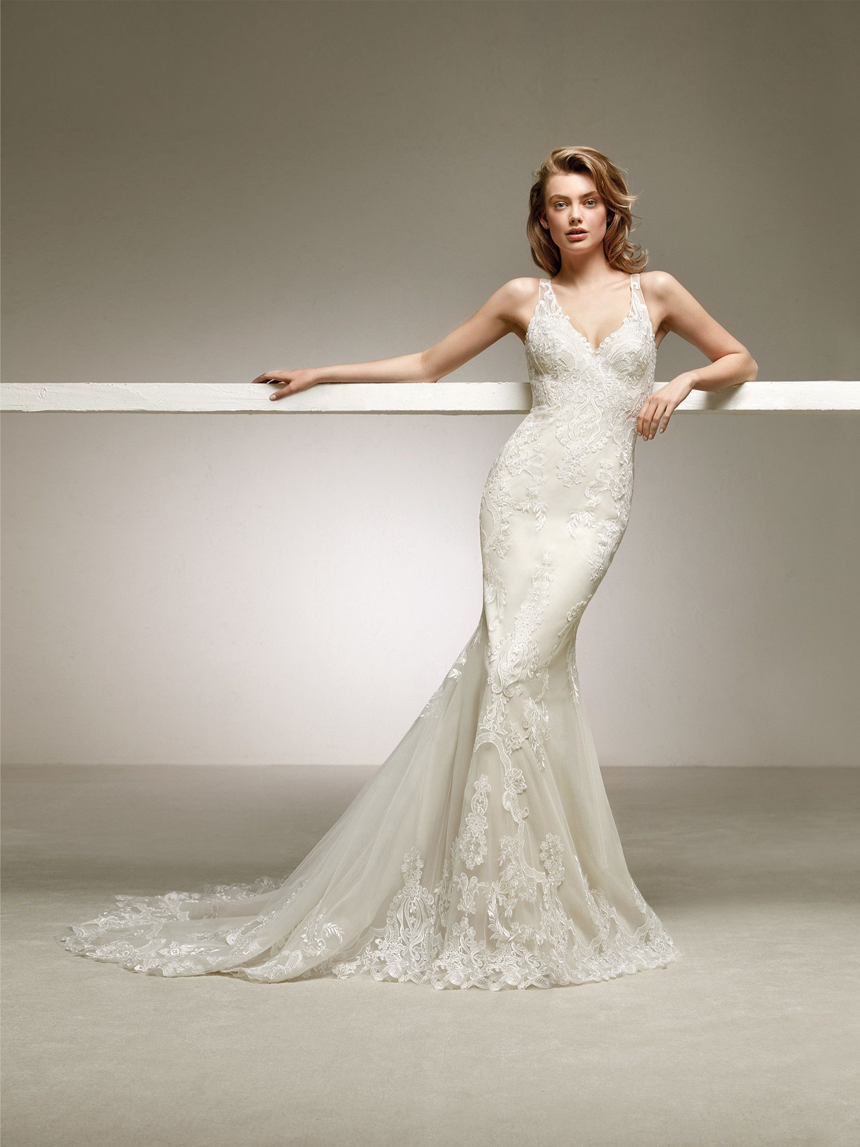 Low Backed Mermaid Wedding Dress With An Embroidered Tulle Placement That Stands Out