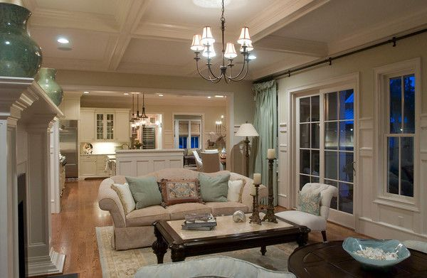 love an open floor plan with great windows!  Too formally decorated for me