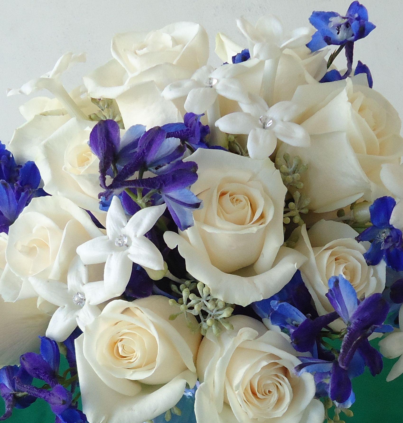White Roses, White Stephanotis With Dark Blue Delphinium
