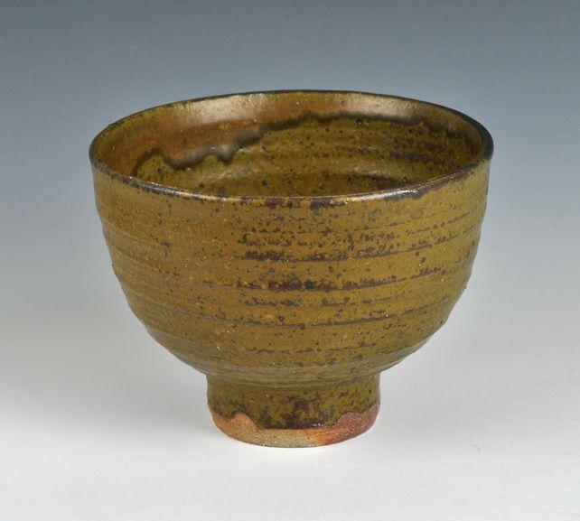 A wood-fired, stoneware tea bowl with ash glaze