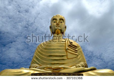 Thai golden Buddha on sky cloud background. - stock photo
