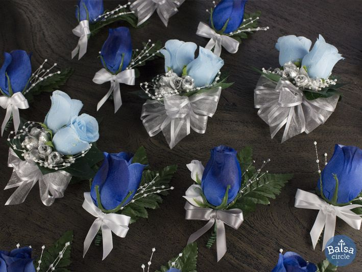 Light Blue Corsages And Royal Blue Boutonnieres With Silver