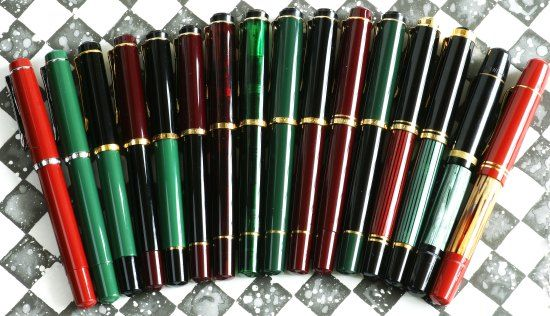 Several different red and green versions of Pelikan fountain pens