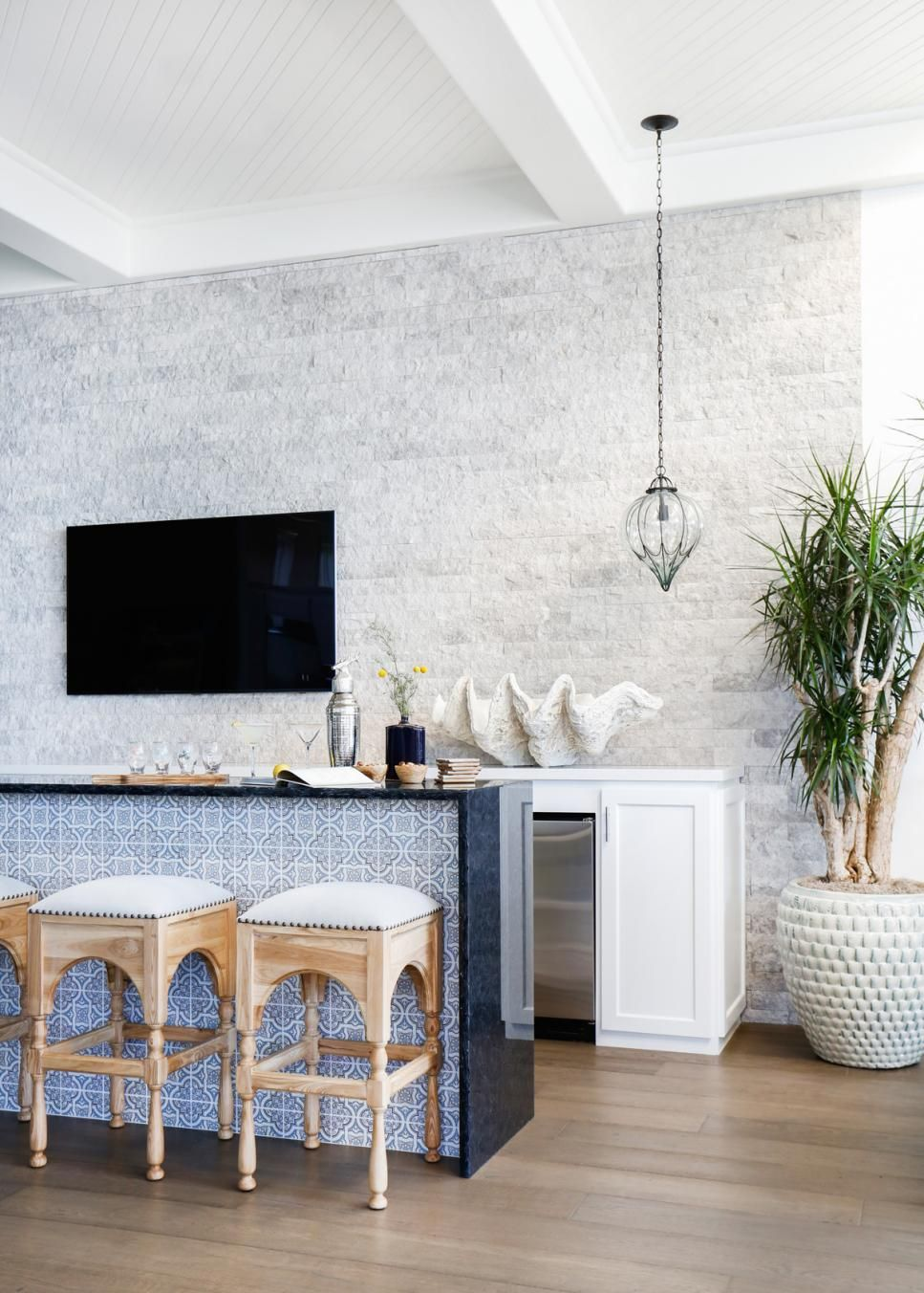 Modern Mediterranean Bar With Stone Accent Wall | Unique Countertops ...