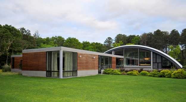 Superior ... Contemporary Home That Is Located On A Site Near An Airport. Quonset  With Addition