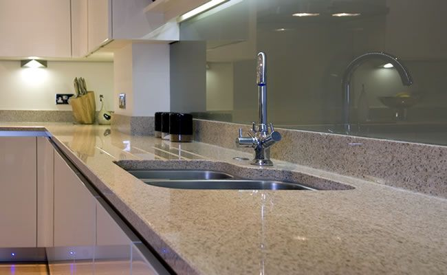 Worktops design matters modern kitchen glass for Sink splashback ideas