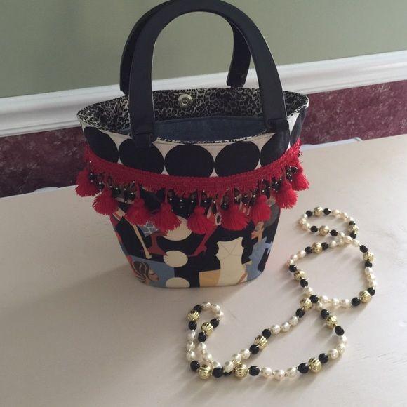 "Sassy Sisterhood Bucket Bag Fringes & Beads Sassy Sisterhood Bucket Bag Fringes & Beads Measurements: 9 x 12 x 3  16"" Handle Bags"