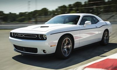 The 2015 Challenger offers an exceptionally smooth drive, with a leather-wrapped shift knob so you can maneuver its 8-speed automatic 8HP70 transmission.  #Dodge #Challenger