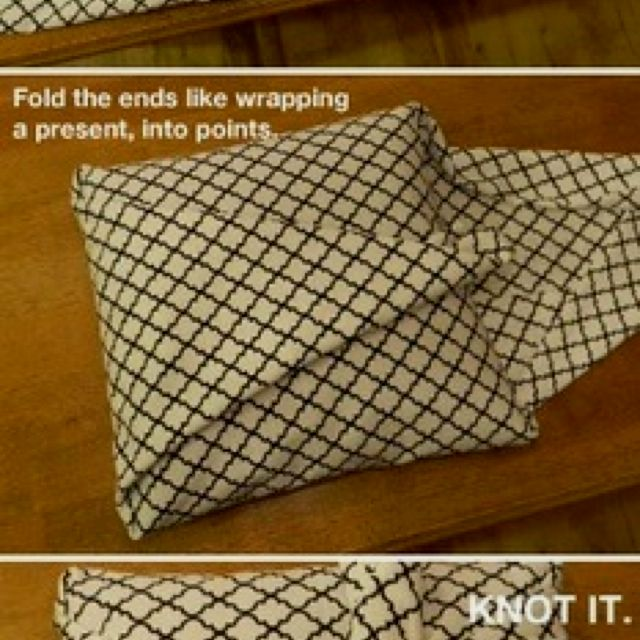 Fabric wrapped pillow, great decorators touch :)