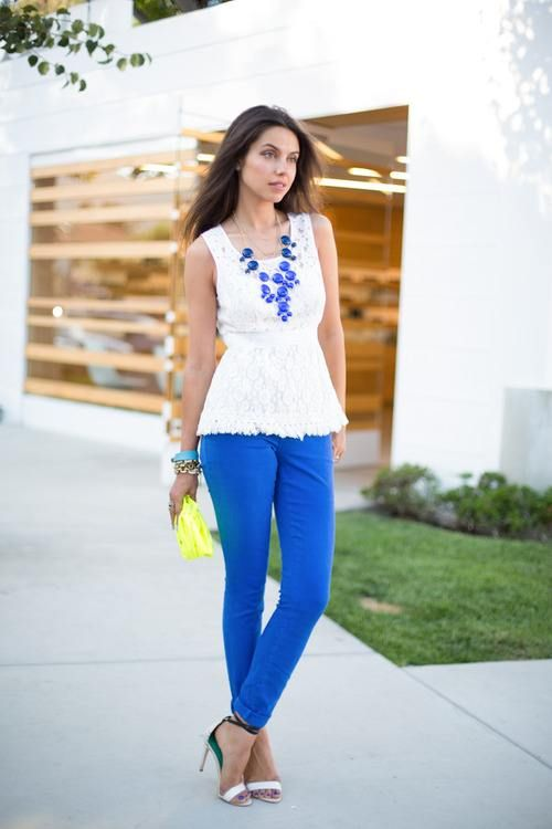 Blue pants with white top and matching necklace