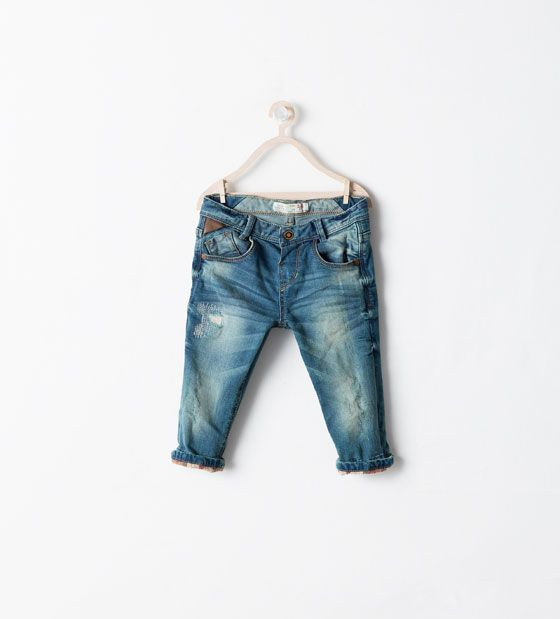 JEANS WITH CHECK TURN-UPS