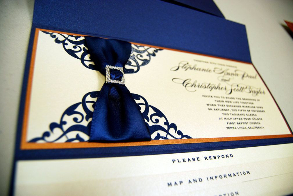 Invites, super expensive though. Equisite Ornate Wedding Invitation with Rhinestone Buckle. $625.00, via Etsy.