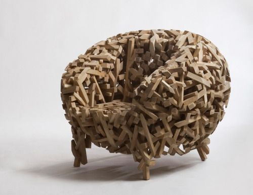 Korean designer Samwoong Lee has created the Crossed Stick Chair, made from a jumble of wood pieces, that have been carved into the shape of a chair.