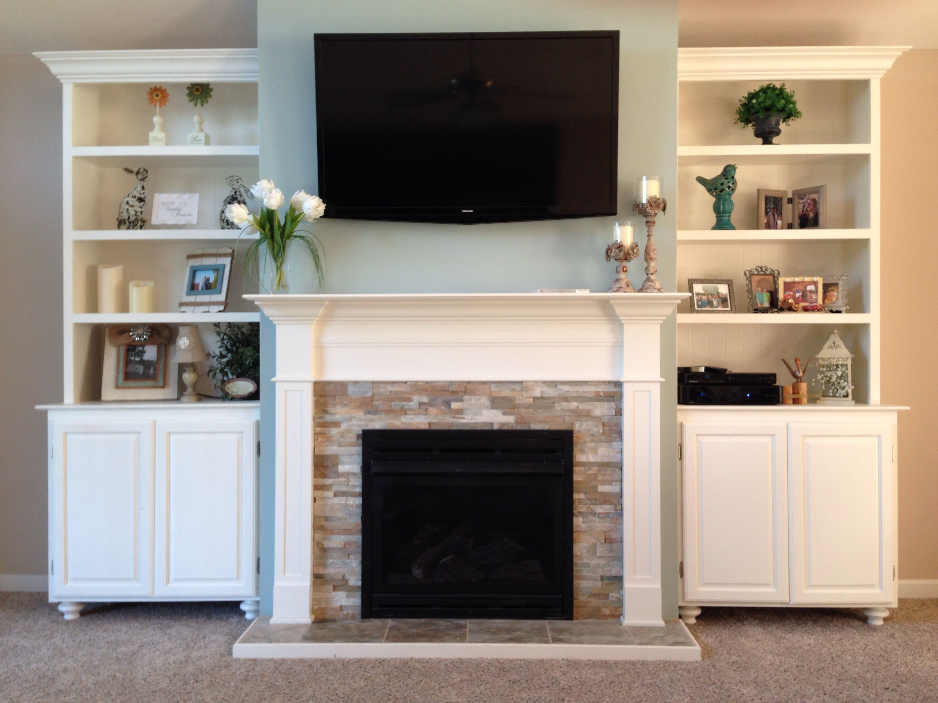 my husband built this beautiful fireplace and matching hutches