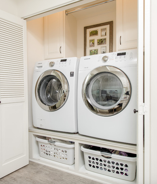 Laundry Room With Elevated Washer Dryer Platform Storage Space