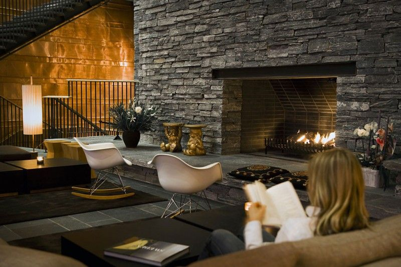 Copperhill Mountain Lodge by AIX Arkitekter Interiors Mid century