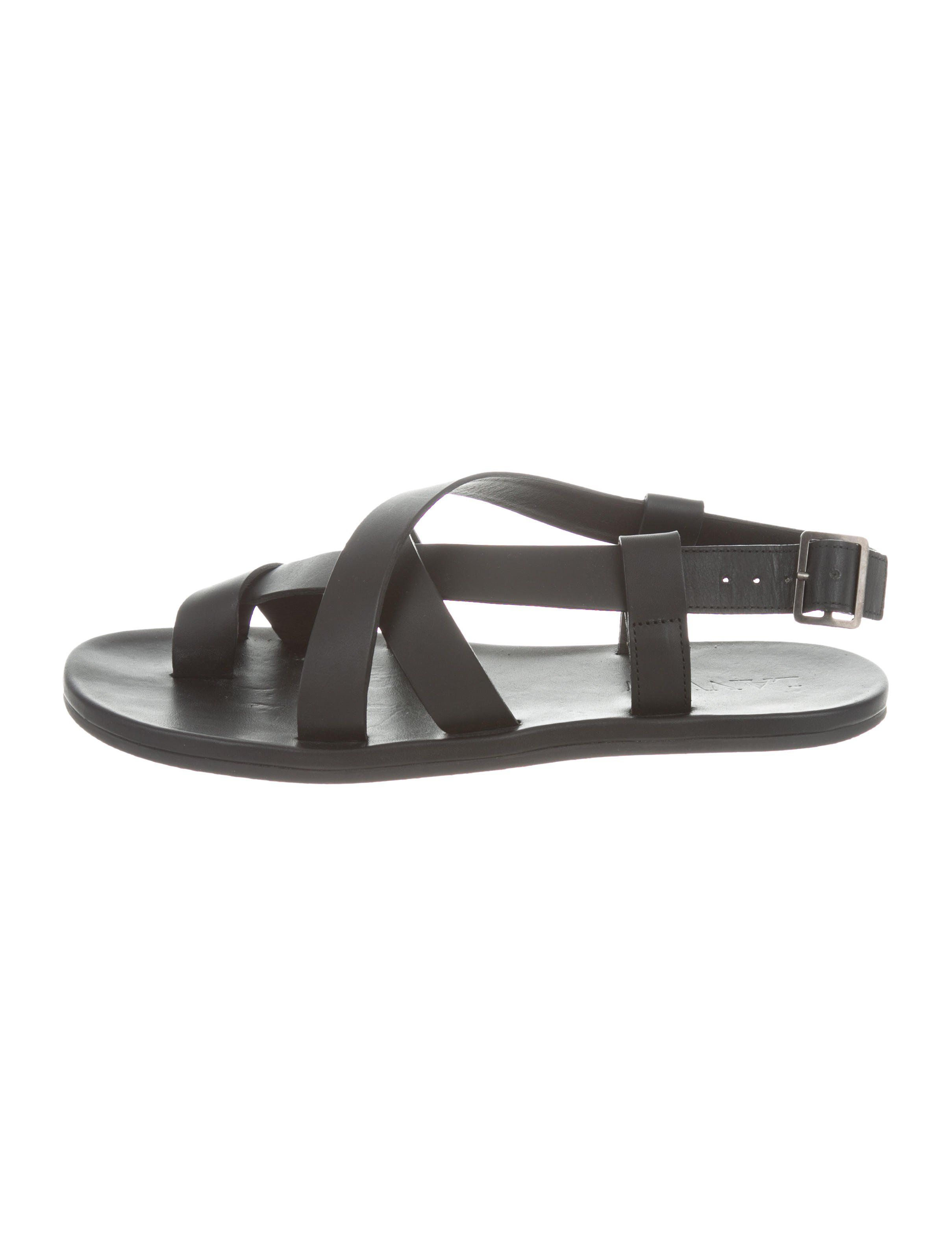 2ca331c9cdf7 Men s black leather Lanvin round-toe sandals with rubber soles and  criss-cross strap buckle closure at counters.Designer Fit  This designer  runs a full size