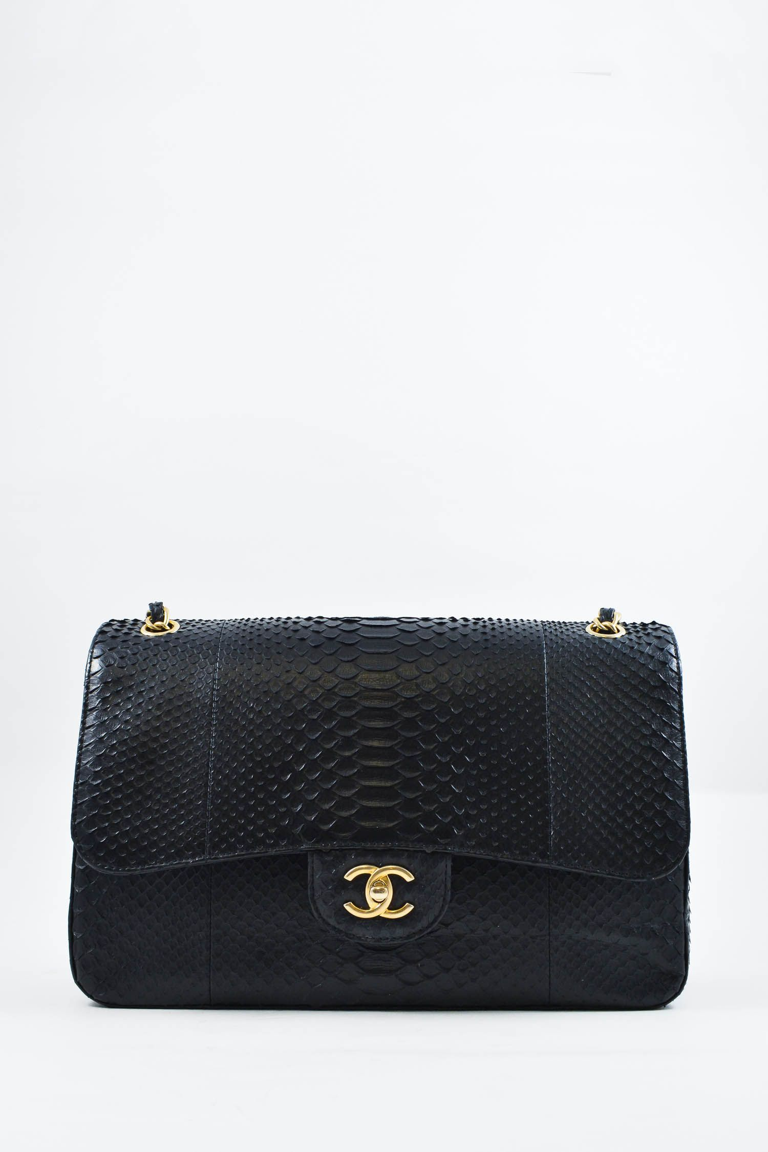 697d7258550b6 Chanel classic jumbo double flap bag in antique black Python with gold  hardware. Features signature Chanel CC turn-lock closure