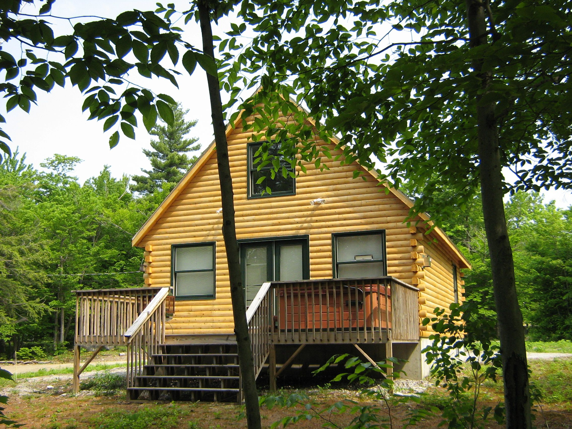 The Mountaineer Cabin at Rivebend Log Homes is a loft style with ...
