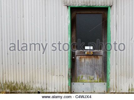 Old Weathered Green Bordered Wood Door On White Corrugated Wall Stock Photo Metal Buildings Corrugated Wall Corrugated Metal