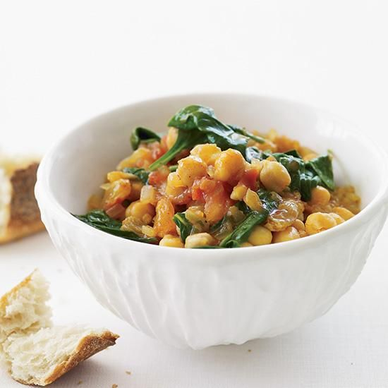 Chickpea and Spinach Stew | In Seville, chickpeas and spinach (garbanzos con espinacas) is a popular dish served in both fine restaurants and tapas bars. It's simple but incredibly tasty, with plenty of flavor from tomato, raisins and saffron.