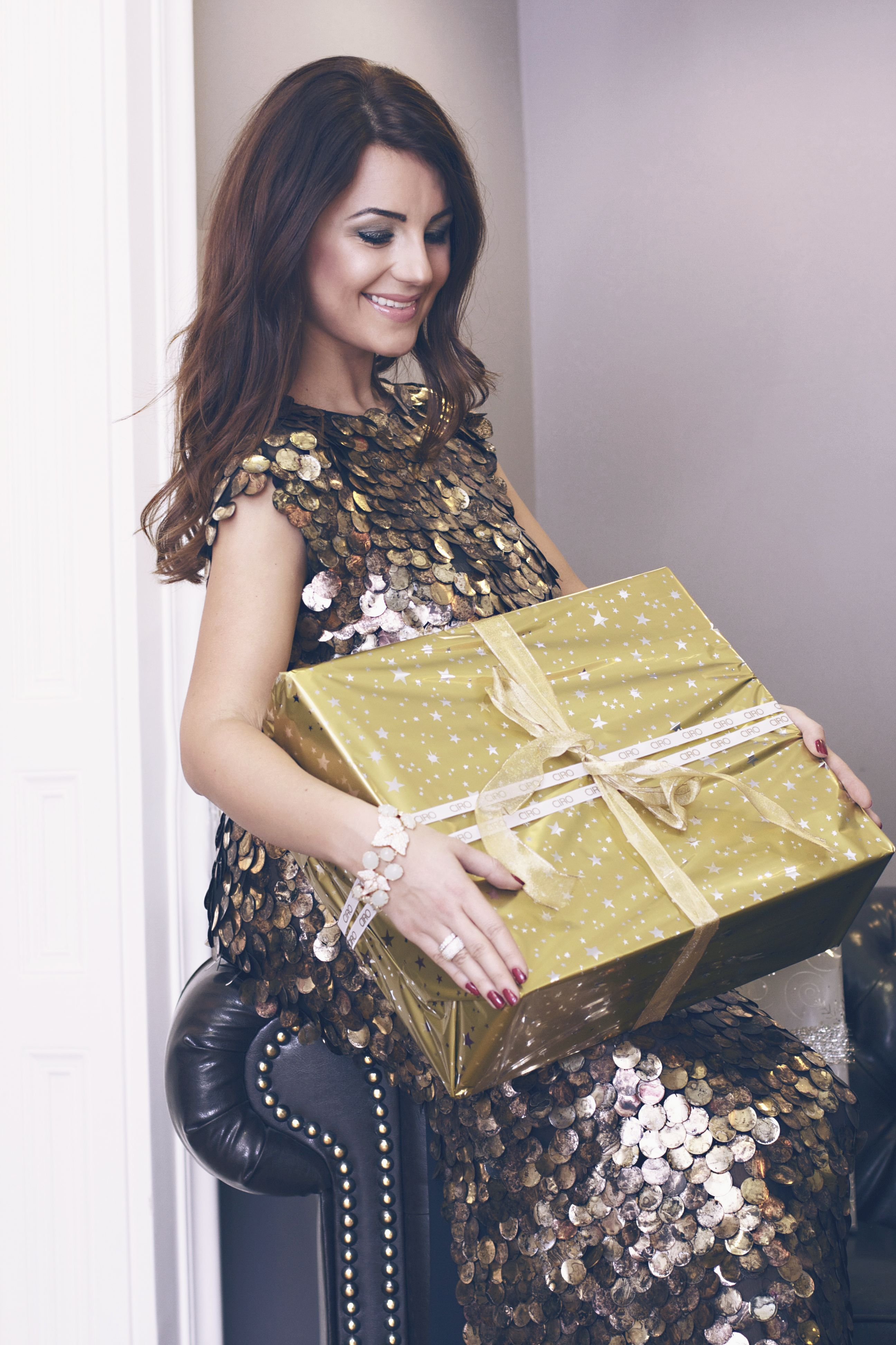 Gold sequin dress for party by Katrin Kafka and CIRO jewelry