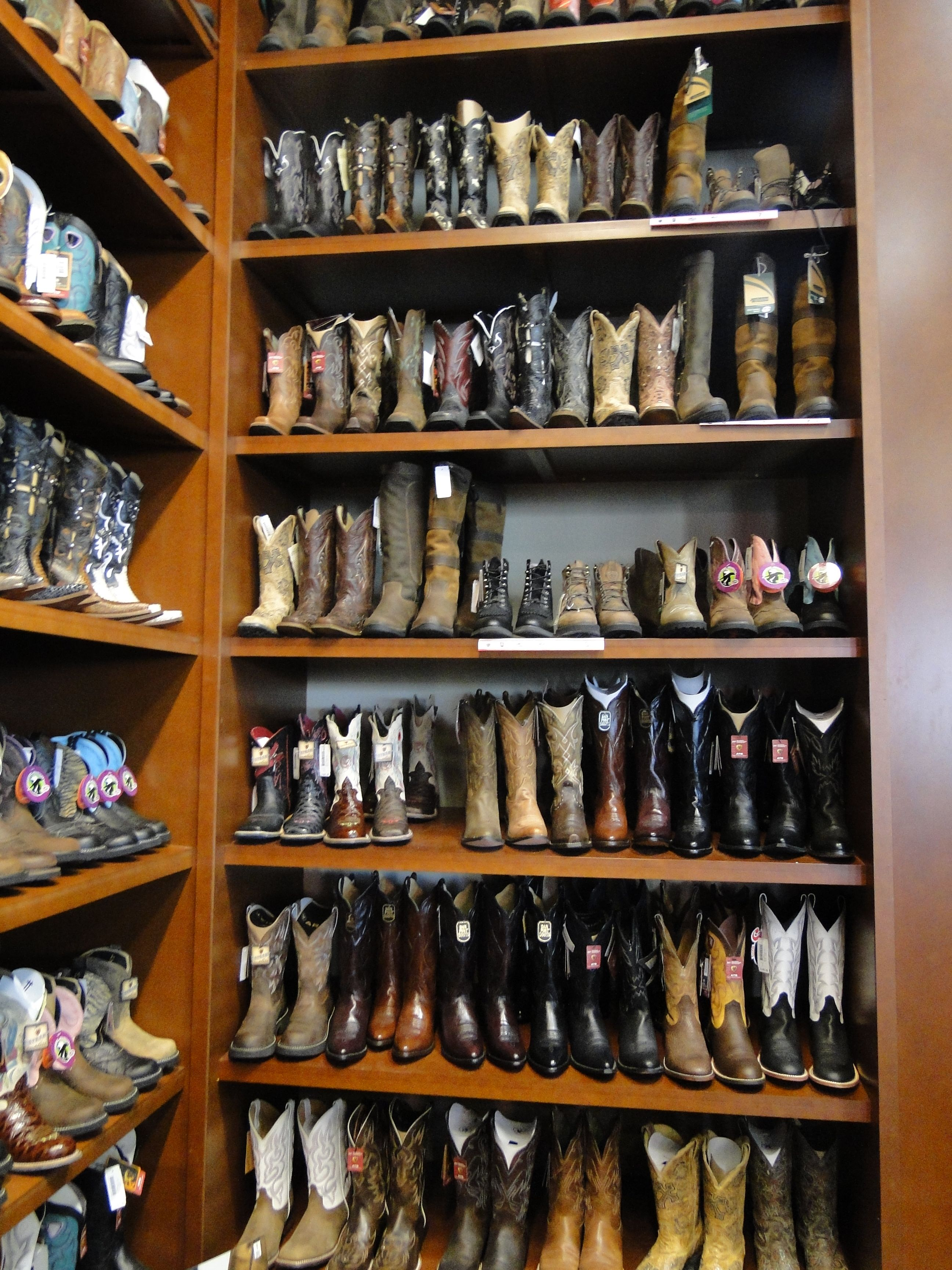 Cowboy/cowgirl boot closet. I want!! Cowgirl boots