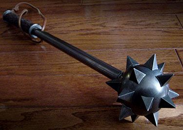 A mace is my weapon of choice.  As a child of Hephaestus, I have a strong enough arm to wield it.