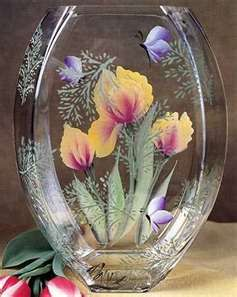 http://nancymaggielee.hubpages.com/hub/Hand-Painted-Glass-Crafts