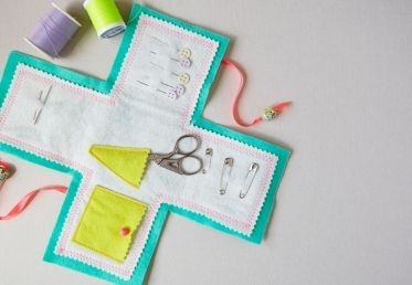 Learn how to create a colorful, travel-sized sewing kit with Annabel Wrigley of Little Pincushion Studio. This simple sewing project uses a pattern template for cutting out felt pieces, and the sewing instructions are easy for new sewists to follow. - Creativebug