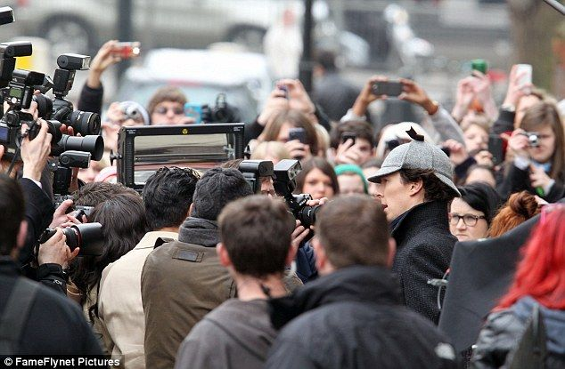 """Benedict Cumberbatch in a deerstalker death frisbee hat :-) on the set of Sherlock S3 -- the caption of this photo reads """"Mobbed: It was difficult to tell where the fans ended and the extras pretending to be paparazzi began""""  .. everyone had been Cumberbatched apparently :-)←this!"""